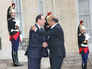 مع فرانسوا هولاند رئيس الجمهورية الفرنسية
